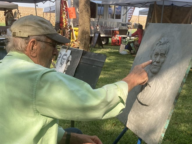 Renowned sculptor John McClarey of Decatur works on a clay bas relief of Abraham Lincoln at the Historic Marbold Farmstead Association's heritage festival Sunday. Elmwood, or the Marbold Mansion, is near Greenview, Illinois.