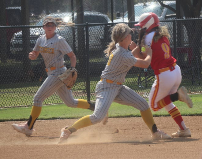 Tecumseh third baseman Katelyn Fleming (center) tags out Dale baserunner Makenzy Herman (9) as Fleming's teammate Bristin Hayes (left) covers third during action Saturday at Dale.