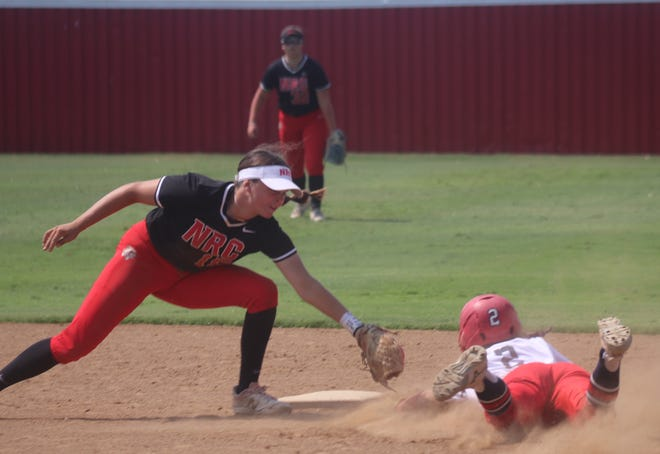 North Rock Creek shortstop Morgan Campbell successfully applies the tag to Minco baserunner Piper Journeycake (2) during play on Saturday at Dale.