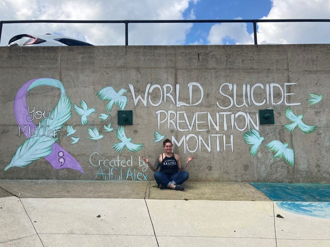 Tattoos by Artful Alex created this chalk mural to help bring awareness to suicide prevention month in uptown Somerset. The mural was sponsored by Somerset Psych Rehab, Croyle-Nielsen Therapeutic Associates Inc., and Somerset County Suicide Prevention Taskforce. Pictured is Artful Alex.