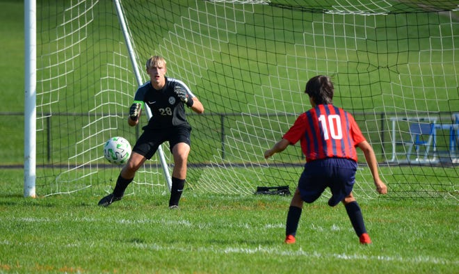 South Hagerstown goalkeeper Aden Mills follows the play against Grace Academy on Saturday.