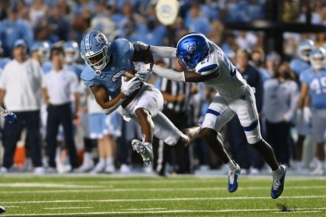 North Carolina Tar Heels receiver Antoine Green (3) catches a pass as Georgia State Panthers cornerback Jaylon Jones (27) defends in the first quarter Saturday night at Kenan Stadium.
