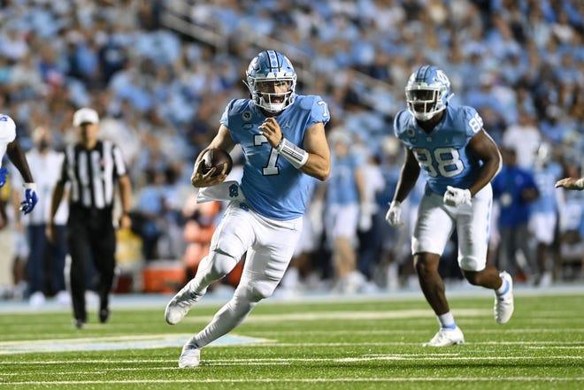 North Carolina quarterback Sam Howell breaks free on a run against Georgia State in the first half Saturday night at Kenan Stadium.