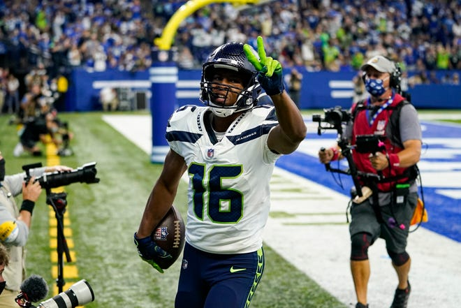 Seattle Seahawks wide receiver Tyler Lockett (16) celebrates after a touchdown against the Indianapolis Colts in the first half of an NFL football game in Indianapolis, Sunday. (AP Photo/Charlie Neibergall)