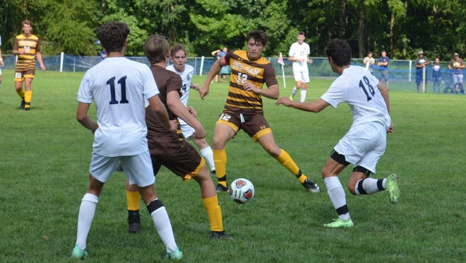 Justin Smith of Delran (12) moves to cut off a run by St. Augustine's Patrick Earnest (18) during Saturday's nonleague meeting of South Jersey soccer powerhouses.