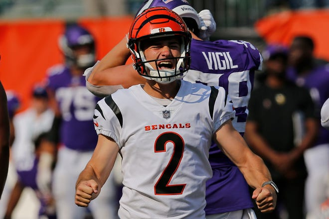 Cincinnati Bengals kicker Evan McPherson (2) celebrates after kicking the game-winning field goal as time runs out in overtime of the NFL Week One game between the Cincinnati Bengals and the Minnesota Vikings at Paul Brown Stadium in downtown Cincinnati on Sunday, Sept. 12, 2021. The Bengals won 27-24 on a last minute field goal in overtime.