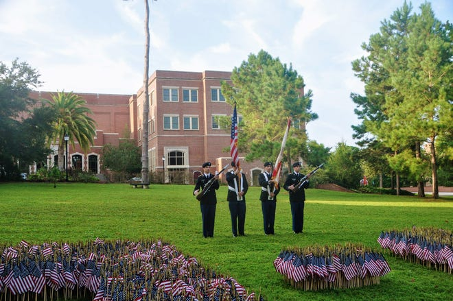 The ceremony included the placement of 2,977 flags honoring the victims of the attacks.