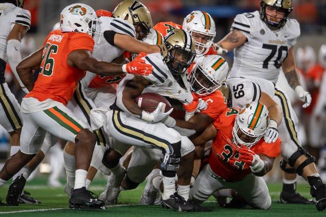 The Colorado State defense takes down Vanderbilt's Re'Mahn Davis on Saturday, Sept. 11, 2021 at Canvas Stadium.