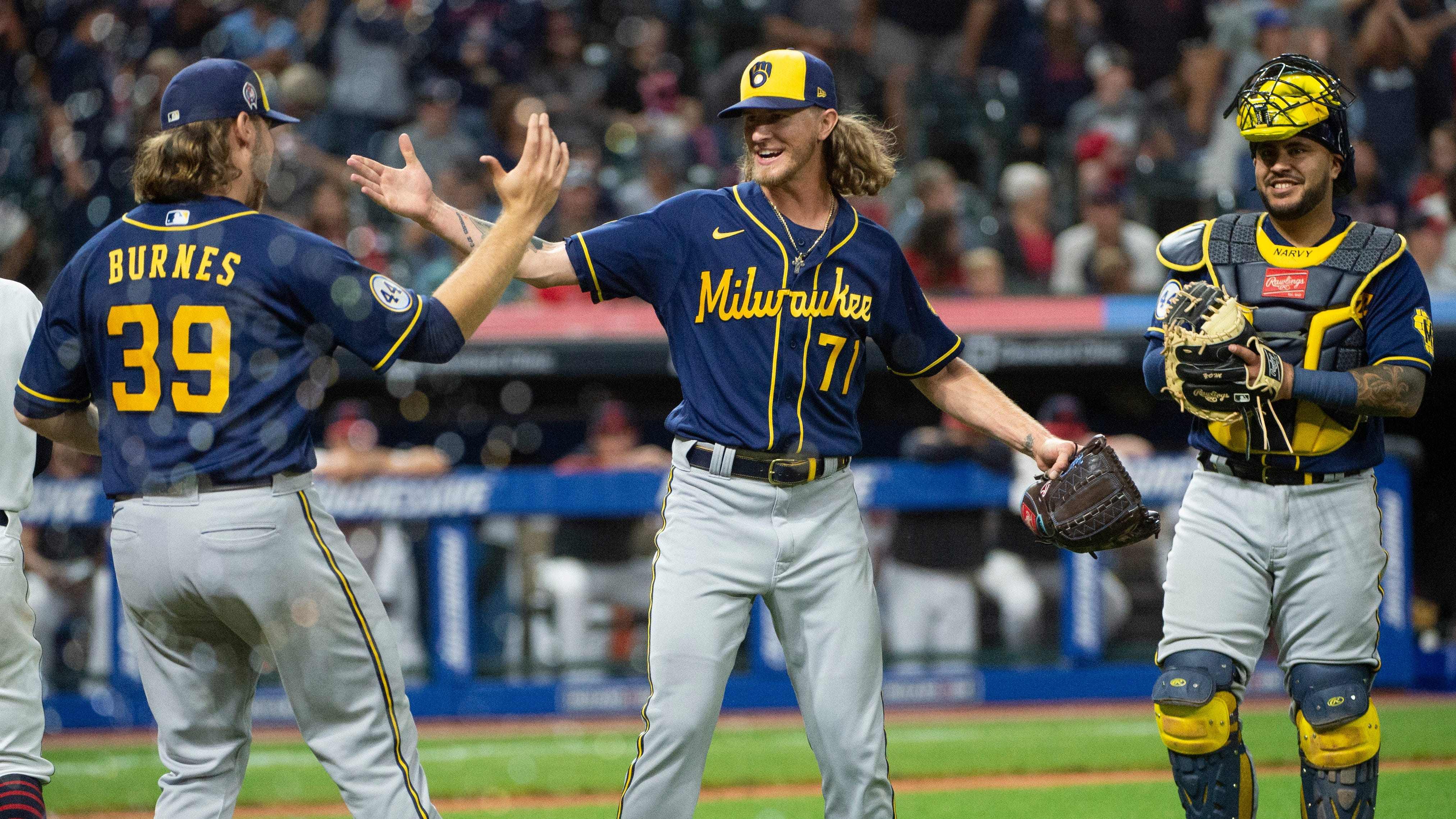 Milwaukee Brewers closer Josh Hader and starting pitcher Corbin Burnes celebrate their combined no-hitter against Cleveland as catcher Omar Narváez is all smiles after the team's 3-0 victory on Saturday, Sept. 11, 2021, at Progressive Field. It was the team's first no-hitter since 1987.