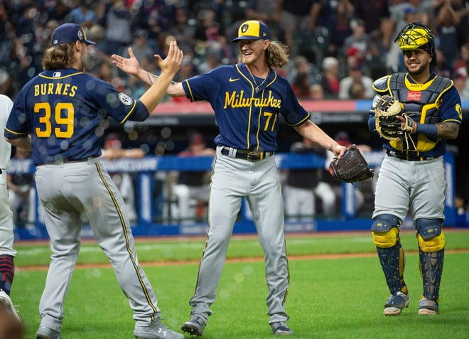 Brewers closer Josh Hader and starting pitcher Corbin Burnes celebrate their combined no-hitter against Cleveland as catcher Omar Narváez is all smiles after the team's 3-0 victory Saturday at Progressive Field. It was the team's first no-hitter since 1987.