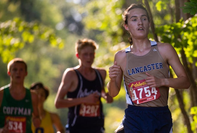 Lancaster's Kaleb Stull (1754) competes against other runners in the McGowan Invitational Cross Country meet at Watkins Memorial High School last week. On Saturday, the Gales won the Central Ohio Cross Country Invitational.