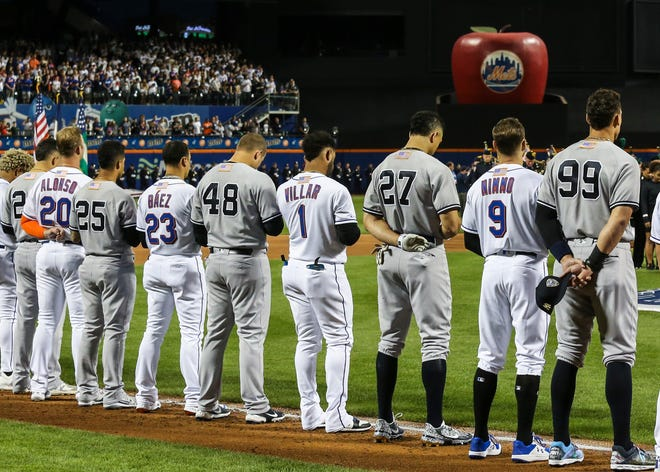 Sep 11, 2021; New York City, New York, USA;  Members of the New York Yankees and New York Mets line up next to each other during the September 11 pre-game ceremonies at Citi Field. Mandatory Credit: Wendell Cruz-USA TODAY Sports