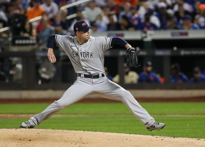Sep 11, 2021; New York City, New York, USA; New York Yankees pitcher Corey Kluber (28) pitches in the first inning against the New York Mets at Citi Field. Mandatory Credit: Wendell Cruz-USA TODAY Sports