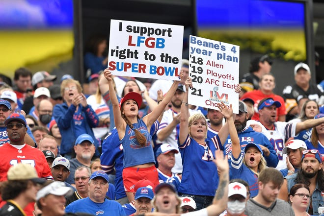 Fans cheer during the first half of an NFL football game between the Buffalo Bills and the Pittsburgh Steelers in Orchard Park, N.Y., Sunday, Sept. 12, 2021.