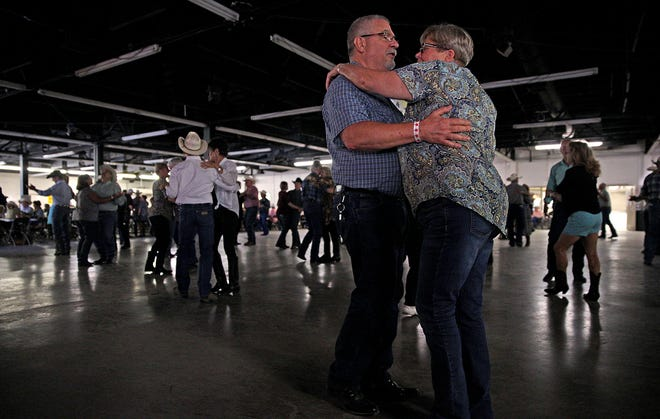 Dance partners take to the floor in the First Financial Pavilion for the annual Cowboy Gathering event Saturday, Sept. 11, 2021.