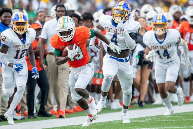 FAMU wide receiver Xavier Smith (19) runs down the sideline during a game between Florida A&M University and Fort Valley State University at Bragg Memorial Stadium in Tallahassee Saturday, Sept. 11, 2021.