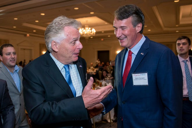 Virginia gubernatorial candidates, Democrat Terry McAuliffe left, and Republican Glenn Youngkin, talk during the Virginia FREE Leadership Luncheon in McLean, Va., Wednesday, Sept. 1, 2021.