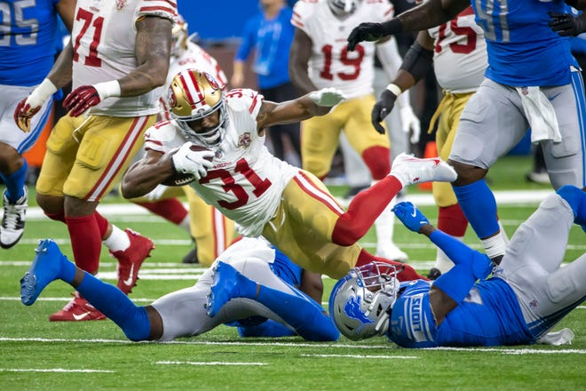Sep 12, 2021; Detroit, Michigan, USA; San Francisco 49ers running back Raheem Mostert (31) runs with the football and is tackled by Detroit Lions defensive back Tracy Walker III (21) in the first quarterat Ford Field. Mandatory Credit: David Reginek-USA TODAY Sports ORG XMIT: IMAGN-451479 ORIG FILE ID:  20210912_jla_kd7_150.jpg