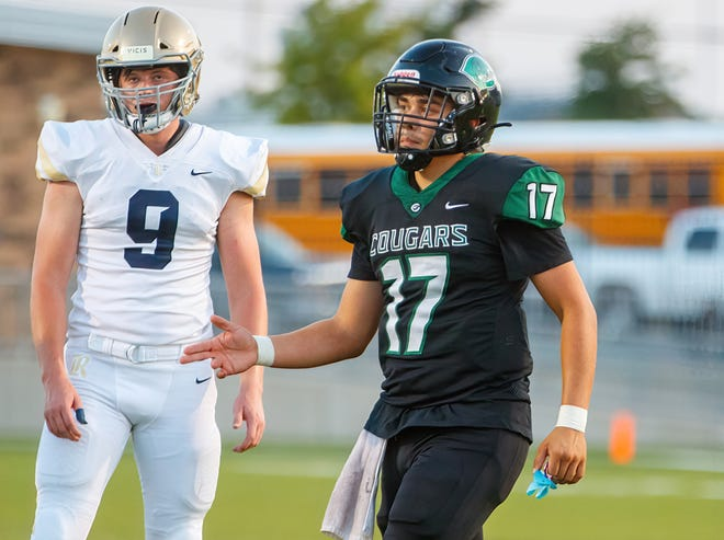 Connally quarterback Justin Santos, right, calls a play in a game against Regents earlier this season. Connally picked up its first win of the season this past week against McCallum.