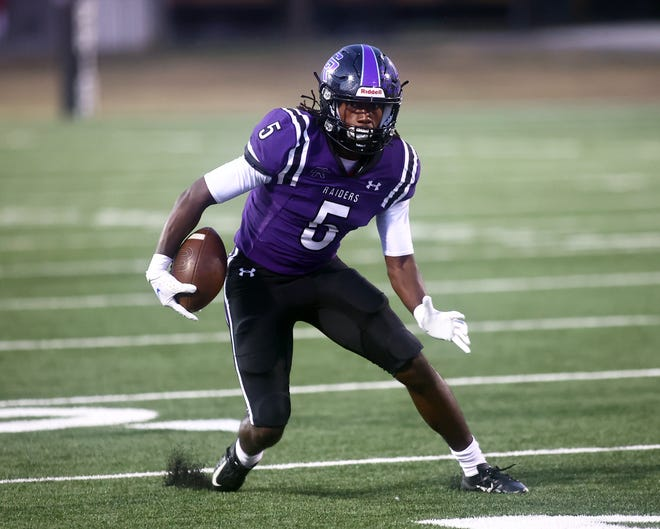 Cedar Ridge's Victor Taylor Jr., getting loose against Hays Friday, had six catches for 194 yards and four touchdowns to lead the Raiders to a 48-13 win in their nondistrict finale.