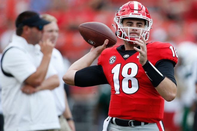 Georgia quarterback JT Daniels (18) throws during warm-ups before the start of an NCAA college football game between UAB and Georgia in Athens, Ga., on Sept 11, 2021. Georgia won 56-7.