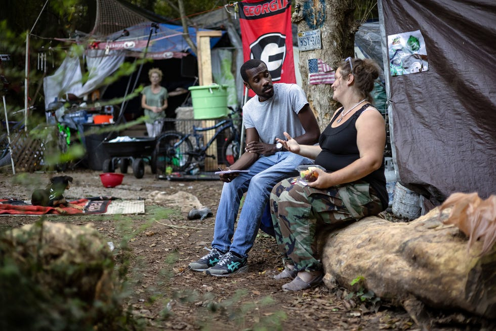 Report for America corps member DJ Simmons interviews Flora Harlow, a woman without permanent housing, at an encampment in Athens on Thursday, Sept. 9, 2021. Simmons is a journalist for the Athens Banner-Herald through RFA reporting on issues Athens' minority and marginalized groups are facing.