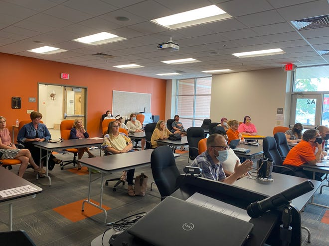 Monday evening's Ashland City Schools Board of Education work session drew a crowd as the board discussed amending the district's COVID protocol to include a six-week mask mandate in schools and on buses.