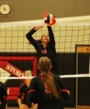 Roland-Story's Ally Ringsby goes for a kill during the Norse volleyball team's sweep of Greene County Sept. 9 at Story City.