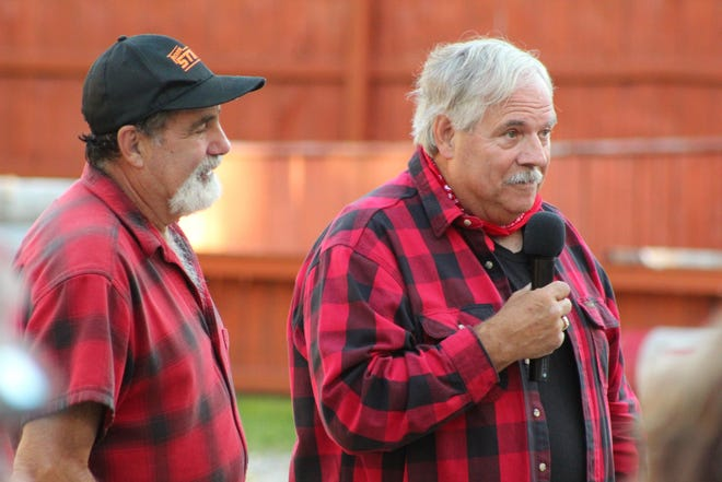 The Cheboygan County Community Foundation Lumberjack Jamboree included some tall tales by community foundation chair Dave Butts (right) about Paul Bunyan, Babe the Blue Ox and Dan McDonough, the owner of the Jack Pine Lumberjack Show.