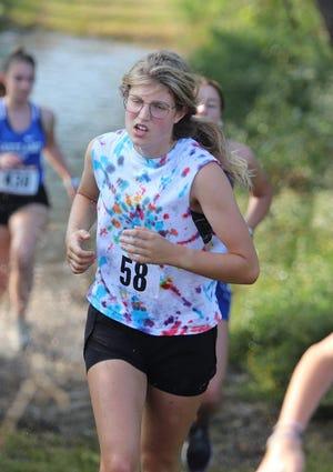 Cheboygan's Elizabeth Harke runs in the girls 11-12 race at the Charlevoix Mud Run on Saturday, Sept. 11.