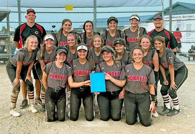 The seniors on the 2021 Chillicothe High School softball Lady Hornets share holding the championship plaque from the Putnam County Invitational tournament Saturday, Sept. 11.