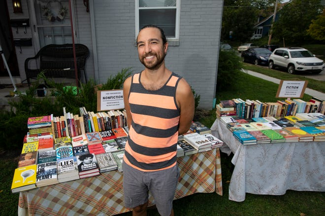 Bookspace owner Charlie Pugsley stands outside his Clintonville apartment building during a Sept. 12 book sale.