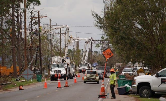 Line workers work to restore power in the Chauvin and Montegut areas in a photo provided Monday by Entergy.