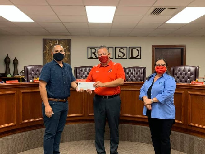 Pictured are Hector Lopez, RISD Board Member and Board of Directors for the Robstown Housing Authority, Superintendent Dr. José Moreno, and Laura Young, Executive Director for the Housing Authority.