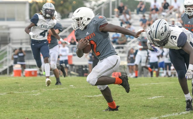 Leesburg's Eric Coffie (2) races to the end zone on Aug. 27 against South Lake at H.O. Dabney Stadium in Leesburg. Coffie ran for 220 yards and three touchdowns in Friday's 42-18 win against Mount Dora. [PAUL RYAN / CORRESPONDENT]