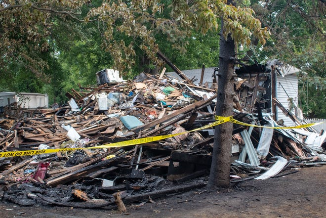 The remnants of a house fire at 131 North Main Street in Creston.