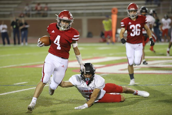 Dodge City High School sophomore Daelyn Unzueta (No. 4), running back for the Red Demons, jukes the Liberal defense and picks up a first down during the first home game at Memorial Stadium on Sept. 10. The Demons played the Liberal Redskins and won with a final score of 48-12. The Red Demons will travel east to play the Wichita South Titans on Sept. 17.