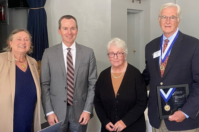 (Right) Past Kiwanis Club of Columbia president Bob Jones is awarded the Hixon Fellowship for his many years of dedicated service to the club and community. (From left) Jan McKeel, Ben Sanders and Tiny Jones celebrate Bob Jones at the Kiwanis Club meeting on Friday.
