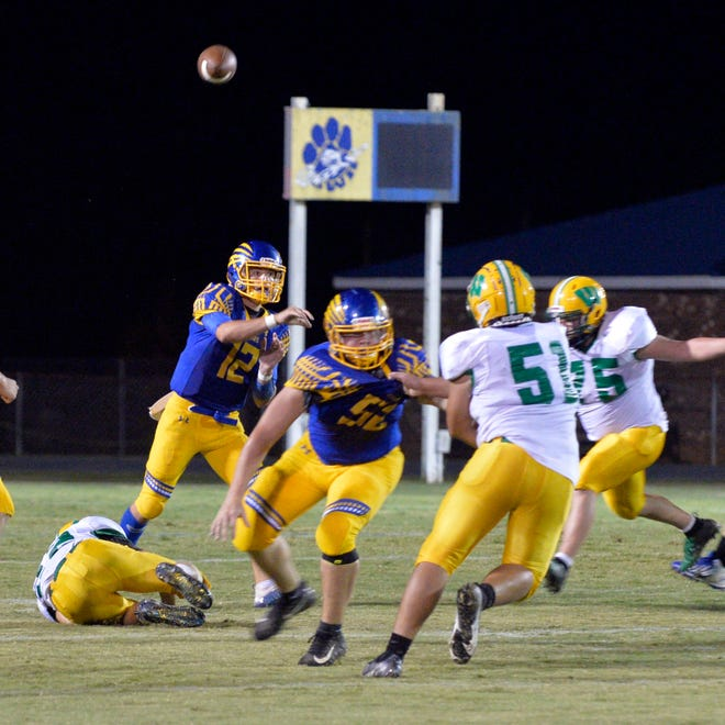 Southwestern Randolph quarterback Keaton Reed throws a pass in the Cougars' 57-10 win over West Davidson. [Mike Duprez/Courier-Tribune]