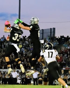 Ledford's Nic Morgan intercepts a pass intended for East Davidson's Logan Irwan early in the game last Friday night at Ledford.