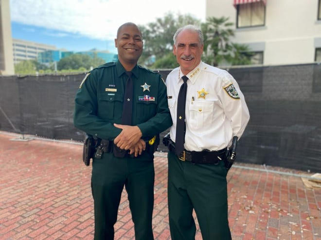 Volusia County sheriff's deputy James Royce (left) poses with Sheriff Mike Chitwood. Both traveled to Tallahassee on Monday where Royce was awarded the Local Law Enforcement Officer of the Year. Royce got the award for rescuing an Oak Hill child taken to a motel by an Orlando man she met online.