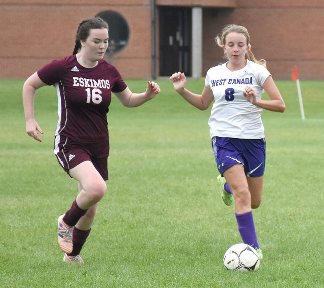 West Canada Valley Indian Gillian Reimer (8) makes a run in the second half with Chelsea Clark (16) defending for Town of Webb during Sunday's championship match at the West Canada Valley Kickoff Tournament.