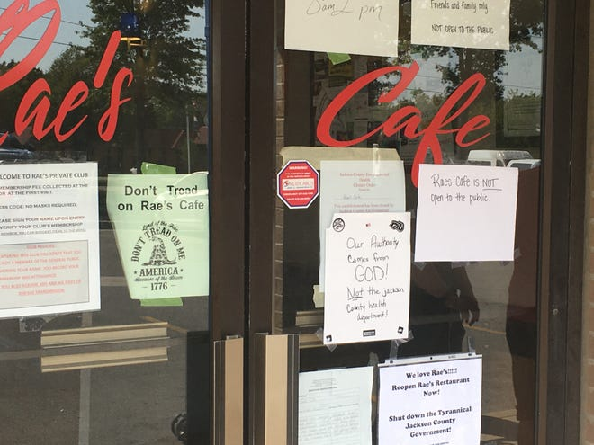 Signs at Rae's Cafe in Blue Springs last week rejected Jackson County's mask mandate.
