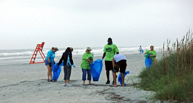 Volunteers cleaning up a stretch of  Jacksonville Beach as during a recent International Coastal Cleanup.