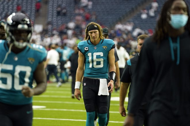 Jaguars quarterback Trevor Lawrence (16) walks off the field after Sunday's loss to the Texans in Houston.