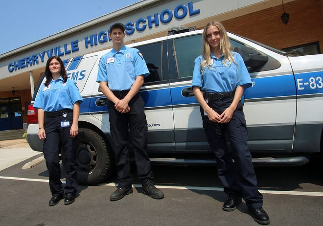 Graduates Jessica Johansen, Trae Costner and Ashlyn Beattie pose together outside Cherryville High School after they talked with students about Gaston College's EMT Apprenticeship 321 Program Monday afternoon, Sept. 13.
