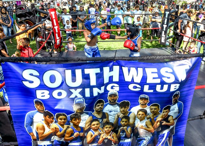 A variety of boxers from the Southwest Boxing Club did exhibition sparring in a ring in Stevens Park during the annual Garden City Community Mexican Fiesta celebration on Saturday.