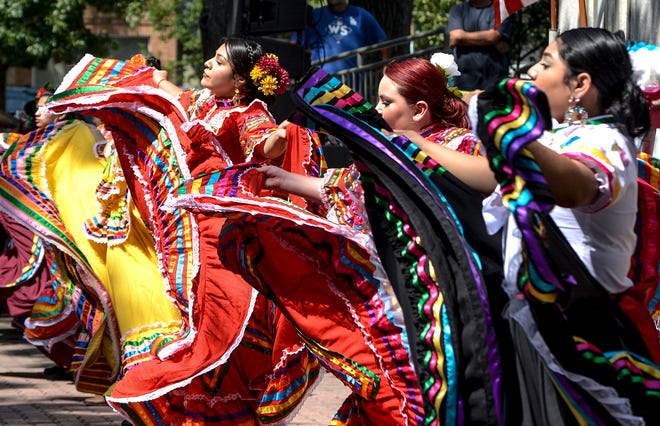 Dancers with Ballet Folklorico Sol De Mexico perform a traditional dance Saturday in Stevens Park during the 95th Garden City Community Mexican Fiesta celebration.  The group was among the entertainment for the afternoon activities in the park.