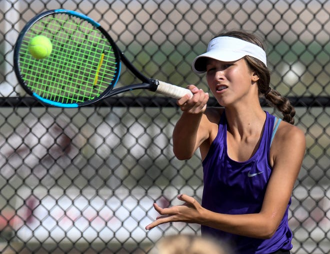 Garden City High School's Sydney Nanninga hits a forehand shot crosscourt during a doubles match in the 2020 GCHS girls tennis invitational at the GCHS tennis complex. Nanninga, and teammate Sage Riggs, won the No. 1 double competition Saturday at Great Bend.
