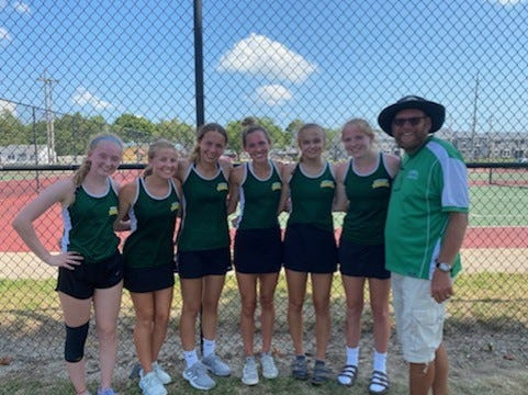 The Geneseo High School Tennis Team won first place at the recent United Township Quad Invite and photographed with Coach Kevin Reed, at right, are from left, Victoria Gray, Aubrey Brumbaugh, Tara Bomleny, Ali Rapps, Annie Turpin and Danielle Beach.